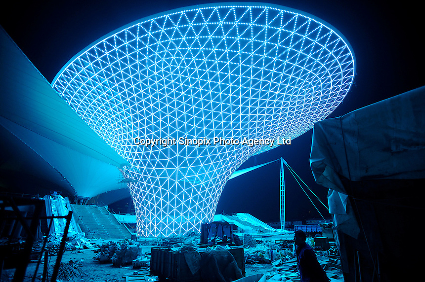 "Lights being tested at the pavilion covering the main entrance for Expo 2010 in Shanghai. Shanghai will play host to China's first World Expo to be held from May 1 to October 31, 2010. The theme for Expo 2010 is ""Better City, Better Life"", which explores the central concerns of urban planning and sustainable development. 200 nations and organizations will take part in the Expo, which is expected to attract some 70 million visitors. The master plan is based on the concept of ""City of Harmony"". Harmony between man and nature, harmony between past, present and future and harmony between human individuals..15 Oct 2009"
