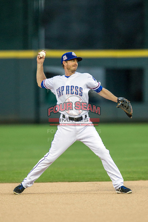 Round Rock Express shortstop Josh Wilson (2) makes a throw to first base during first inning of the Pacific Coast League baseball game against the New Orleans Zephyrs on May 27, 2014 at the Dell Diamond in Round Rock, Texas. The Zephyrs defeated the Express 9-0 in a rain shortened game. (Andrew Woolley/Four Seam Images)