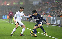 Son Heung-Min of Spurs & Tom Carroll of Swansea City   during the Premier League match between Swansea City and Tottenham Hotspur at the Liberty Stadium, Swansea, Wales on 2 January 2018. Photo by Mark Hawkins / PRiME Media Images.