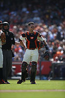 SAN FRANCISCO, CA - SEPTEMBER 29:  Buster Posey #28 of the San Francisco Giants smiles on the field during a break in the action against the Los Angeles Dodgers during the game at Oracle Park on Sunday, September 29, 2019 in San Francisco, California. (Photo by Brad Mangin)