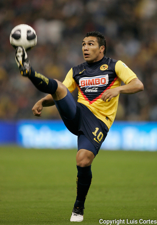 America Aguilas' forward Salvador Cabanas drives the ball during a soccer match against Monterrey Rayados in the Aztec Stadium in Mexico City. Monterrey beat America 1-1 (2-1 on aggregate) and goes to the semifinal in the national soccer league. Photo by Luis Cortes