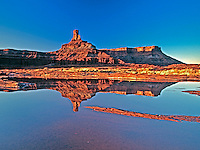 Deadhorse Chimney in Canyonlands National Park in Utah reflects in a small pond after a spring rain