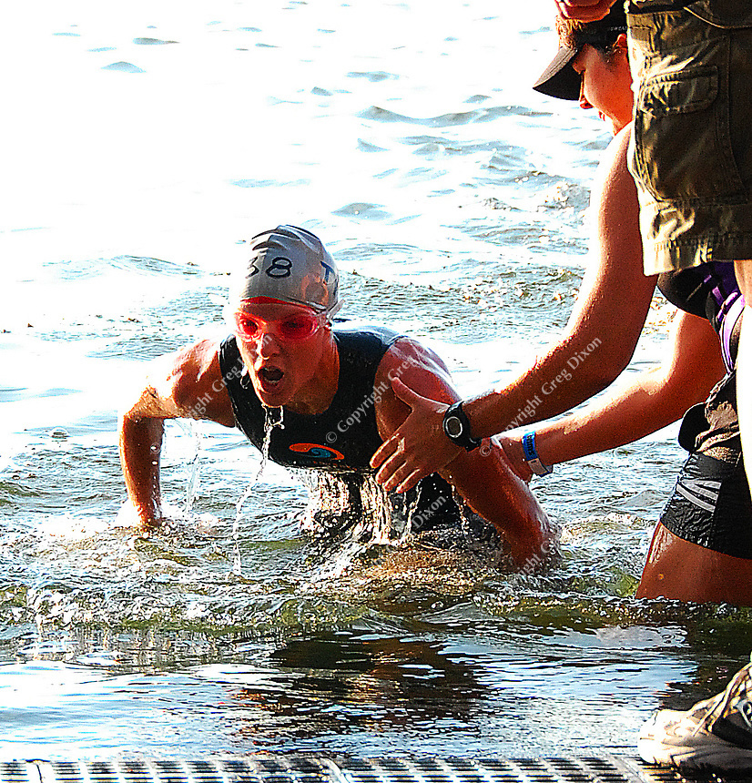 Overall women's winner Gina Ferguson is the first woman out of the water Sunday, 9/9/07, at the end of the first leg of the Ironman