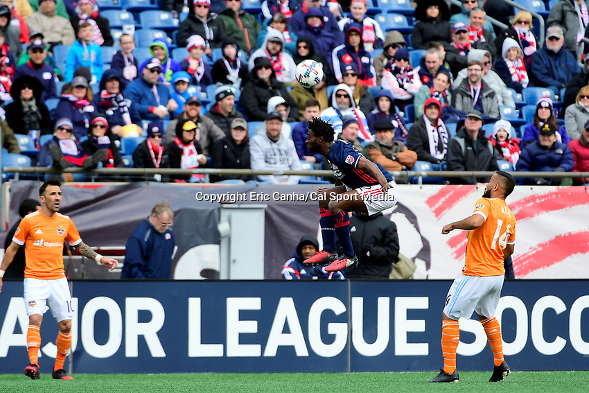 Saturday, April 8, 2017: New England Revolution midfielder Laglais Kouassi (12) heads the ball during the MLS game between Houston Dynamo and the New England Revolution held at Gillette Stadium in Foxborough Massachusetts. New England defeats Houston 2-0. Eric Canha/CSM