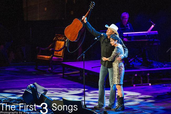 "Alan Jackson and Nancy Jones perform at the George Jones Tribute Concert ""Playin' Possum: The Final No Show"" at Bridgestone Arena in Nashville, TN"