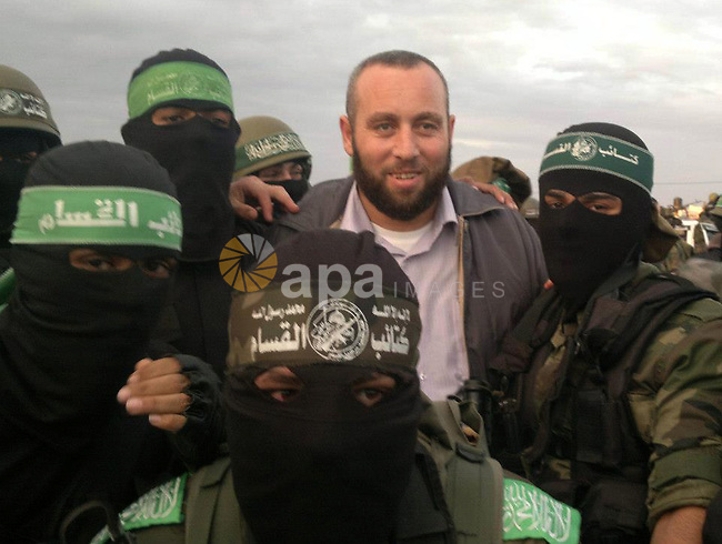 A handout picture dated February 26, 2014 and released by Hamas Press Office on August 21, 2014, shows the senior Hamas commander, Raed al-Atar (L), in the southern Gaza Strip town of Rafah. Three senior Hamas commanders, including al-Atar, were among at least 15 Palestinians killed in Gaza early on August 21, as Israel stepped up air strikes on day 45 of the bloody conflict. The Brigades, the military wing of Hamas which holds de facto power in Gaza, identified the three as Mohammed Abu Shamala, Raed al-Atar and Mohammed Barhum. APAIMAGES / HO / HAMAS PRESS OFFICE