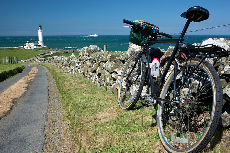 Cycling in the Rhins of Galloway Scotland UK looking down on Corsewall Lighthouse Hotel looking across the North Channel to Ireland