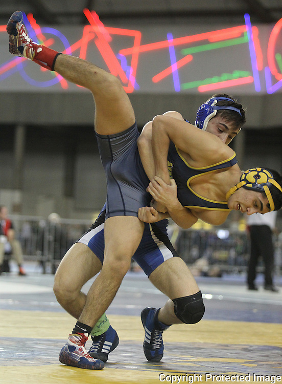 Eatonville's Tanner Frost upends Naches Valley's Josue Navaro in their 132 pound match on Saturday, February 20, 2016 at the Mat Classic XXVIII Championship matches held in the Tacoma Dome. Frost placed 6th in the championships.  (Jim Bryant Photo)