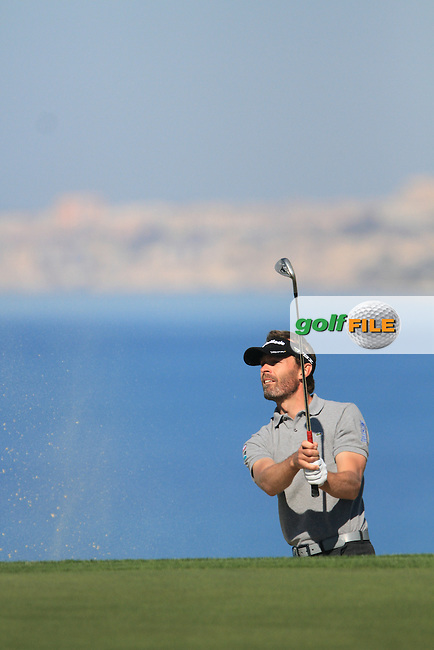 Raphael Jacquelin (FRA) hits onto the 18th green on the 1st Day of the 2012 Sicilian Open at Verdura Golf and Spa Resort...(Photo Jenny Matthews/www.golffile.ie)
