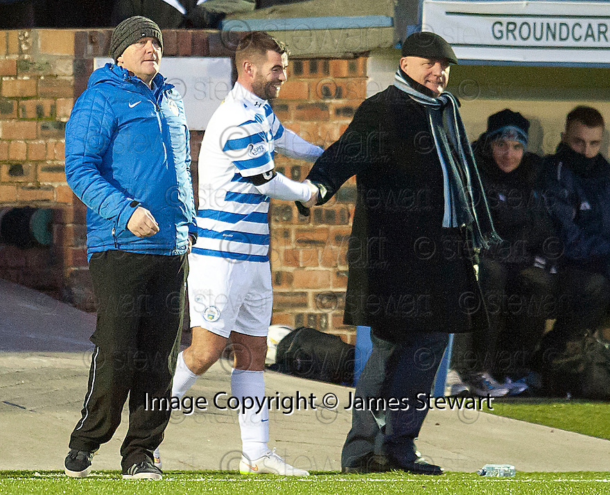 Forfar manager Dick Campbell shares a joke with Morton's Peter MacDonald (as he is substituted .