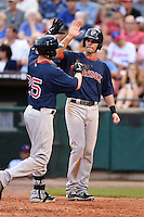 Pawtucket Red Sox second baseman Justin Henry (7) high fives outfielder Bryce Brentz (25) after a home run during a game against the Buffalo Bisons on August 26, 2014 at Coca-Cola Field in Buffalo, New  York.  Pawtucket defeated Buffalo 9-3.  (Mike Janes/Four Seam Images)