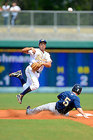 Montgomery Biscuits second baseman Robi Estrada #5 attempts to turn a double play as Mike Freeman #5 slides in during a game against the Mobile BayBears on April 16, 2013 at Riverwalk Stadium in Montgomery, Alabama.  Montgomery defeated Mobile 9-3.  (Mike Janes/Four Seam Images)