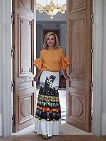 A portrait of interior designer Emma Pilkington in her family home.