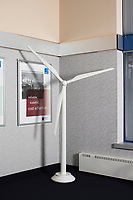 A model of a wind turbine is visible in a conference room in the old headquarters of American Superconductor, also known as AMSC, an energy technology company now based in Ayer, Massachusetts. This image is from the old headquarters in Devens, Massachusetts, USA, seen on Tues., Jan. 30, 2018. AMSC manufacturers electronic control systems for wind turbines such as this one. AMSC was the victim of the theft of trade secrets, starting in 2011 when the Chinese company Sinovel worked to steal and modify AMSC's proprietary wind turbine-running software. Sinovel was AMSC's largest customer, and McGahn estimates that 70% of China's wind turbines now run software stolen from AMSC. AMSC has received favorable judgments from American and Chinese courts, and the company contends that it is owed billions of dollars as a result of the theft, which almost destroyed the company. When news of the theft came out, the company's stock value decreased substantially and went from approximately 800 employees to fewer than 200. The company has rebounded some since the crime.