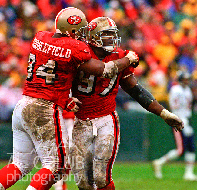 San Francisco 49ers vs. Chicago Bears at Candlestick Park Saturday, January 7, 1995.  49ers beat Bears 44-15.  San Francisco 49ers defensive tackles Dana Stubblefield (94) and Bryant Young (97) celebrate sack.