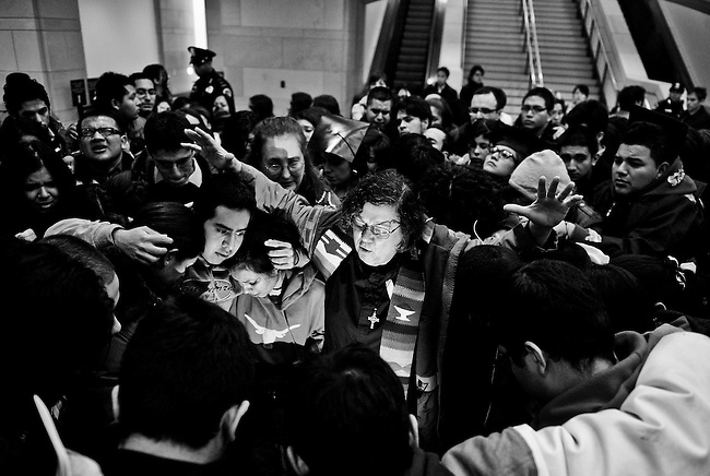 DREAM Act supporters cry, pray and chant in the Capitol Visitor Center after watching the DREAM Act's defeat from the Senate Gallery on Dec. 18, 2010.