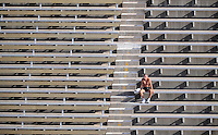 Nov. 28, 2009; Tempe, AZ, USA; An Arizona State Sun Devils fan watches from the upper deck in the first quarter against the Arizona Wildcats at Sun Devil Stadium. Arizona defeated Arizona State 20-17. Mandatory Credit: Mark J. Rebilas-