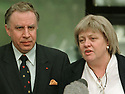 Northern Ireland Secretary Mo Mowlam, right, and junior secretry Paul Murphy,left, comment after the settlement of the Northern Ireland peace negotiations at the Stormont Castle Buildings in Belfast Friday, April 10, 1998.  (AP Photo/ Paul McErlane)