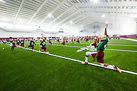 TALLAHASSEE, FLA.8/6/13-FSU080613CH-The Florida State University football team stretches during their first use of their indoor practice facility, Aug. 6, 2013 in Tallahassee, Fla.<br /> <br /> COLIN HACKLEY PHOTO