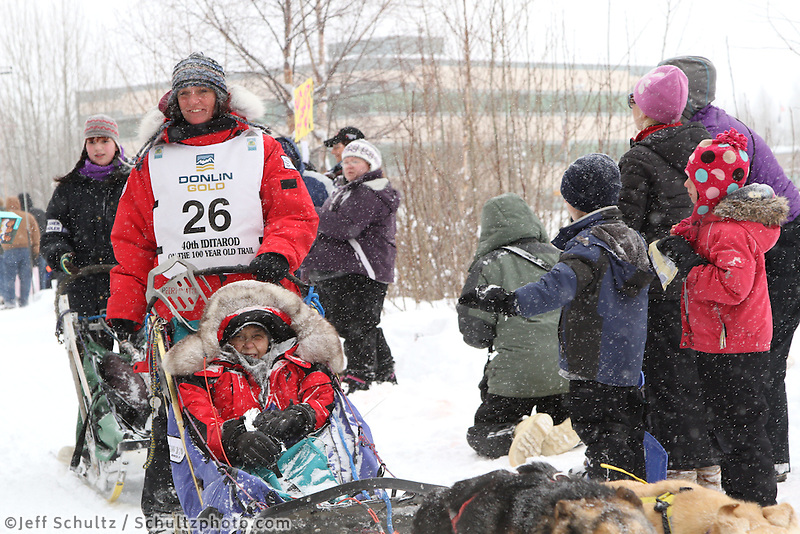Michelle Phillips Mushes through Bike/ski trail in midtown Anchorage, During the 2012 Iditarod ceremonial start..Britt Coon/Iditarodphotos.com.