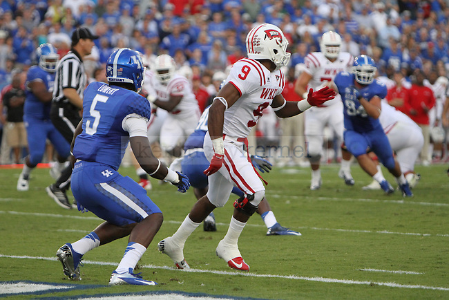 Ashely Lowery prepares to defend against WKU's Marcus Vasquez during the University of Kentucky football game against Western Kentucky University, and Commonwealth Stadium in Lexington, Ky., on Saturday September 15th. Photo by Kirsten Holliday