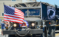A military vehicle waves the American flag during the Independence Parade Saturday July 2, 2016 on Beach Avenue in Cape May, New Jersey. Photo by William Thomas Cain/Cain Images