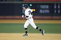 Chris Lanzilli (24) of the Wake Forest Demon Deacons rounds the bases after hitting a home run against the Sacred Heart Pioneers at David F. Couch Ballpark on February 15, 2019 in  Winston-Salem, North Carolina.  The Demon Deacons defeated the Pioneers 14-1. (Brian Westerholt/Four Seam Images)