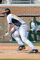 Ethan Bennett #21 of the Tennessee Volunteers follows through on a swing at Lindsey Nelson Stadium against the the Manhattan Jaspers on March 12, 2011 in Knoxville, Tennessee.  Tennessee won the first game of the double header 11-5.  Photo by Tony Farlow / Four Seam Images..