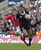 25/05/2002 (Saturday).Sport -Rugby Union - London Sevens.Wales vs New Zealand.Eric Rush tracked by Arwel Thomas[Mandatory Credit, Peter Spurier/ Intersport Images].