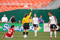 Referee Sandra Serafini issues a yellow card to United States midfielder Carli Lloyd (11) after a foul on Canada forward Christine Sinclair (12). The women's national team of the United States defeated Canada 6-0 during an international friendly at Robert F. Kennedy Memorial Stadium in Washington, D. C., on May 10, 2008.