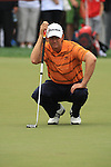 Retief Goosen lines up his putt on the 8th green on day two of the Abu Dhabi HSBC Golf Championship 2011, at the Abu Dhabi golf club, UAE. 21/1/11..Picture Fran Caffrey/www.golffile.ie.