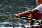 Rowing, Male elite rower in a single racing shell, detail of hands, arms and legs, blur motion,.