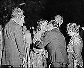 As United States Secretary of State Cyrus Vance, left, and U.S. President Jimmy Carter, second left, look on, Prime Minister Menachem Begin of Israel, right center, gives first lady Rosalynn Carter, center left, a kiss on the cheek after arriving on the South Lawn of the White House by helicopter from Camp David on September 17, 1978. President Anwar al-Sadat of Egypt, is partially obscured at second right and Aliza Begin, wife of the Prime Minister, is at right..Credit: CNP