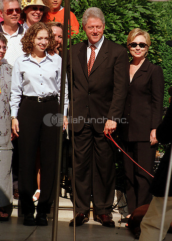 Clintons pose for a family portrait as they depart the White House for their two week vacation on August 19, 1999.  The President celebrated his 53rd birthday earlier in the day at a party thrown for him by approximately 200 members of the White House staff and volunteers on the South Lawn. (L-R) Chelsea Clinton, U.S. President Bill Clinton, First Lady Hillary Rodham Clinton..Credit: Ron Sachs / CNP/MediaPunch
