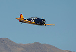 Michael Pfleger competes in his T-6G plane called Midlife Madness during the National Championship Air Races at the Reno-Stead Airfield Friday, Sept. 18, 2015.