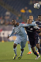 Sporting Kansas City midfielder C.J. Sapong (17) and New England Revolution defender Didier Domi (3) battle for the ball. In a Major League Soccer (MLS) match, the New England Revolution defeated Sporting Kansas City, 3-2, at Gillette Stadium on April 23, 2011.