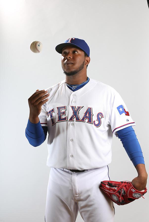 Feb. 20, 2013; Surprise, AZ, USA: Texas Rangers pitcher Neftali Feliz poses for a portrait during photo day at Surprise Stadium. Mandatory Credit: Mark J. Rebilas-