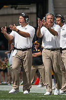 Iowa head coach Kirk Ferentz (clapping on right). Iowa Hawkeyes defeated the Pitt Panthers 24-20 at Heinz Field, Pittsburgh Pennsylvania on September 20, 2014.