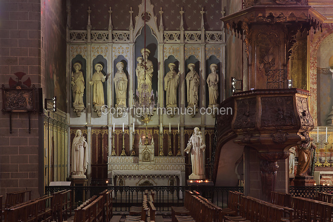 Altarpiece and pulpit in St Joseph's Chapel, Perpignan Cathedral, Perpignan, Pyrenees-Orientales, France. The 19th century altarpiece is in neogothic style and features statues of clerics and monastic founders including (left-right) St Sebastian, St Francis of Assisi, St Augustin, St Joseph holding the Christ child, St Antony, St Thomas Aquinus, St Germaine. The Cathedral Basilica of Saint John the Baptist of Perpignan, or Basilique-Cathedrale de Saint-Jean-Baptiste de Perpignan was begun in 1324 by King Sancho of Majorca in Catalan Gothic style, and later finished in the 15th century. The cathedral is listed as a national monument of France. Picture by Manuel Cohen