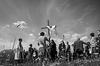 A group of faithful climbs on top of the restricted archaeological site of Monte Testaccio to celebrate the traditional Via Crucis (Way of the Cross).