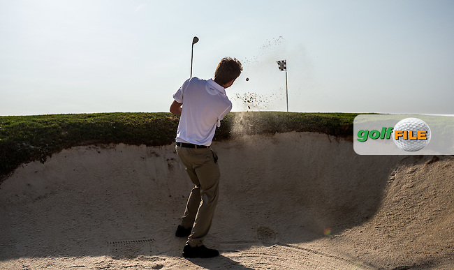 Playing from a deep fronted bunker at Al Zorah Golf Club, Dubai, United Arab Emirates.  26/01/2016. Picture: Golffile | David Lloyd<br /> <br /> All photos usage must carry mandatory copyright credit (&copy; Golffile | David Lloyd)