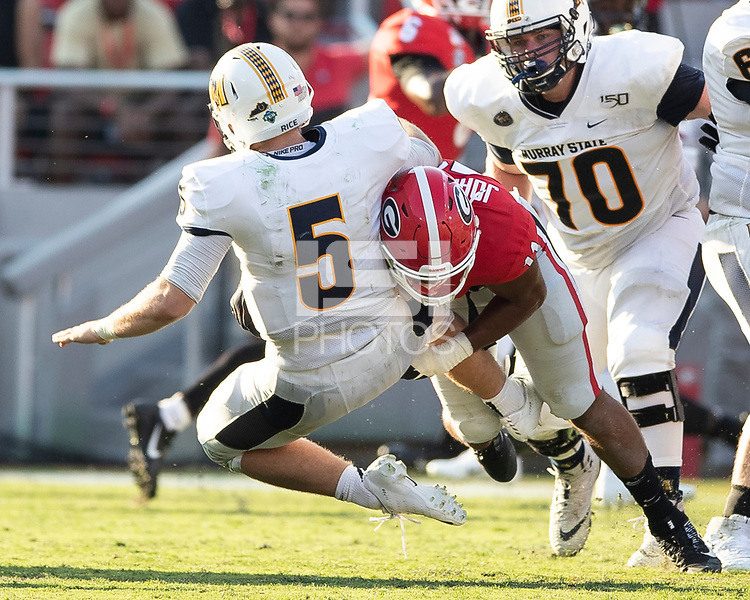 ATHENS, GA - SEPTEMBER 7: Preston Rice #5 is tackled to the ground after a pass by Jermaine Johnson #11 during a game between Murray State Racers and University of Georgia Bulldogs at Sanford Stadium on September 7, 2019 in Athens, Georgia.