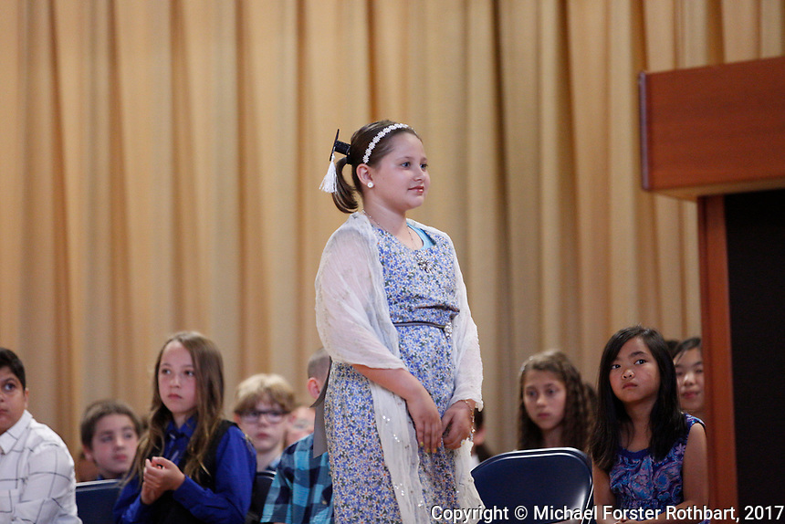 The Oneonta Greater Plains elementary school fifth grade awards ceremony, on June 21, 2017.<br /> &copy; Michael Forster Rothbart Photography<br /> www.mfrphoto.org &bull; 607-267-4893<br /> 34 Spruce St, Oneonta, NY 13820<br /> 86 Three Mile Pond Rd, Vassalboro, ME 04989<br /> info@mfrphoto.org<br /> Photo by: Michael Forster Rothbart<br /> Date:  6/21/2017<br /> File#:  Canon &mdash; Canon EOS 5D Mark III digital camera frame C19197