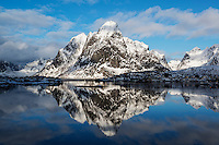 Snow covered Olstind mountain peak rising above Reine, Moskenesøy, Lofoten Islands, Norway