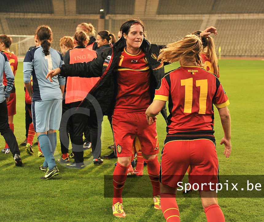 20130921 - BRUSSELS , BELGIUM : Belgian Cecile De Gernier (7) pictured dancing after the female soccer match between Belgium and Albania , on the first matchday in group 5 of the UEFA qualifying round to the FIFA Women World Cup in Canada 2015 at the Koning Boudewijn Stadion , Brussels . Saturday 21th September 2013. PHOTO DAVID CATRY