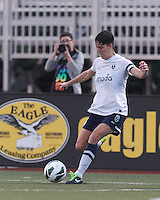 Seattle Reign FC midfielder Keelin Winters (11) passes the ball.  In a National Women's Soccer League (NWSL) match, Seattle Reign FC (white) defeated Boston Breakers (blue), 2-1, at Dilboy Stadium on June 26, 2013.