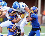 BROOKINGS, SD - SEPTEMBER 10:  Christian Rozeboom #2, Chris Balster #28 and Jordan Brown #9 from South Dakota State bring down Eric Saubert #85 from Drake during their game at the Dana J. Dykhouse Stadium Saturday night in Brookings. (Photo by Dave Eggen/Inertia)