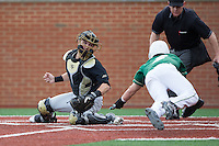 Wake Forest Demon Deacons catcher Logan Harvey (15) prepares to put the tag on Reece Hampton (2) of the Charlotte 49ers as he slides into home plate at Hayes Stadium on March 16, 2016 in Charlotte, North Carolina.  The 49ers defeated the Demon Deacons 7-6.  (Brian Westerholt/Four Seam Images)