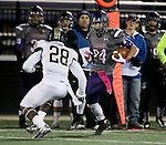 SIOUX FALLS, SD - OCTOBER 4: Garrett Shutt #24 from the University of Sioux Falls looks to make a move past Marc St. Louis #28 from Concordia St. Paul in the second half of their game Saturday evening at Bob Young Field.(Photo by Dave Eggen/Inertia)