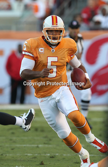 Tampa Bay Buccaneers quarterback Josh Freeman (5) scrambles for a first down against the Atlanta Falcons during an NFL football game Sunday in Tampa, Fla, December 5, 2010. The Falcons defeated the Buccaneers 28-24. (AP/Margaret Bowles)